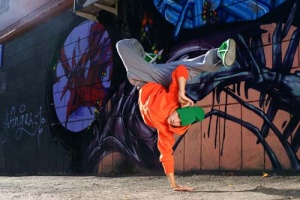 boy dancing on the street graffity wall